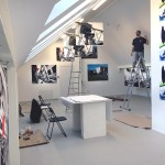 Graduate student and graphic designer Vytis Snarskis installing 112x152cm photographic works at Meno Parkas Galerija